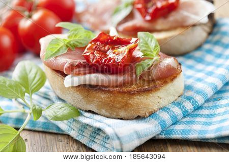 bruschetta with parma ham, sundried tomatoes and fresh basil