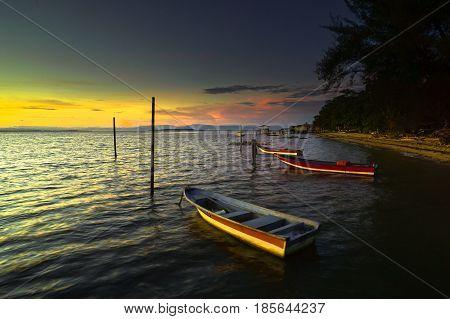 Labuan,Malaysia-May 10,2017:Fishing boats during beautiful sunrise in Tanjung Aru village,Labuan island,Malaysia.