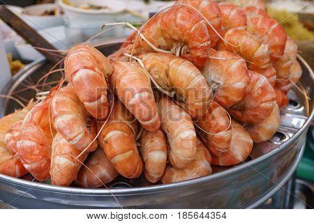 group of delicious streaming jumbo shrimps prawn in Thai street food market.