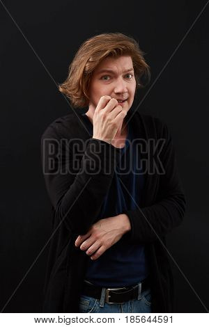 Model hiding face shame. Isolated on black backround