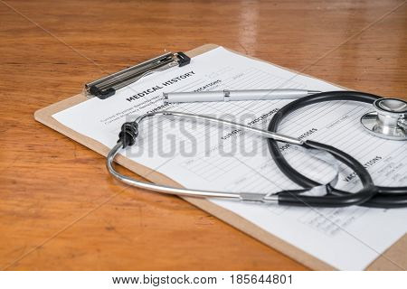 Medical Record on Clipboard with Stethoscope on a Desk