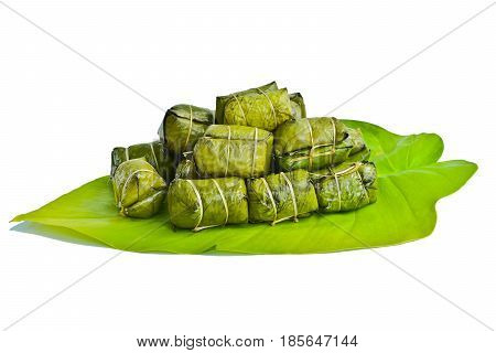 Bananas with sticky rice (Khao Tom Mat or Khao Tom Pad) put on green leaf isolate white background Traditional Thai dessert style