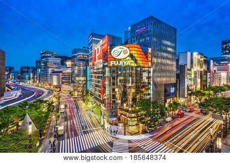 TOKYO, JAPAN - MAY 9, 2017: The Ginza district at night. Ginza is a popular upscale shopping area of Tokyo.
