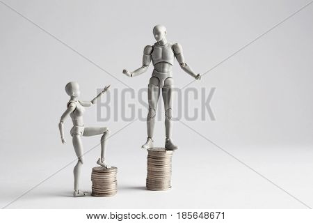 Income Inequality Concept Shown With Figurines
