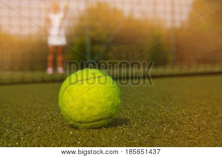 Tennis Ball And Silhouette Of Tennis Player