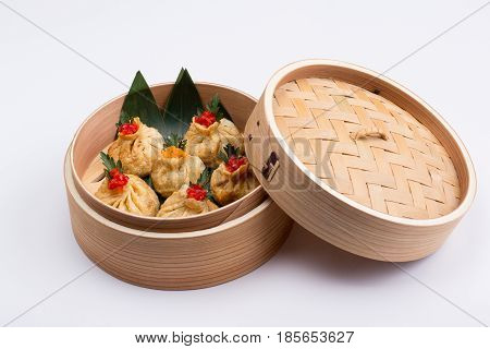 Fresh And Hot Manti Dumplings In Bamboo Steamer.