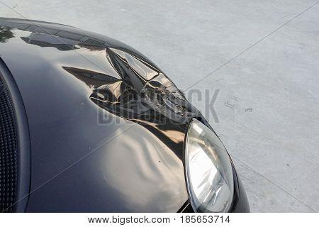 crashed car on front bonnet - Black car accident