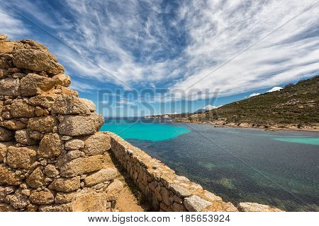 Stone Wall Of Derelict Building And Translucent Sea In Corsica