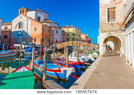 Chioggia - September 2016, Italy: Street of Chioggia - the town also known as a part of Venice. Boats lying on water in central canal