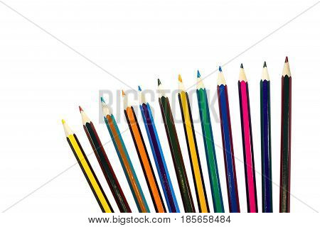 Colored pencils isolated on a white background, laid out by a fan