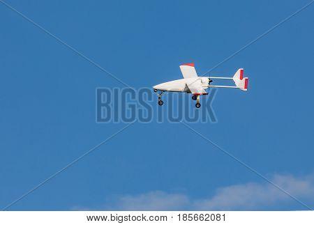 Unmanned aerial vehicle (UAV) in blue sky.