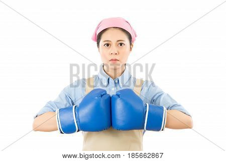 Aggressive Woman Punching Boxing Gloves