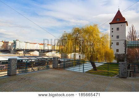 Prague Czech Republic - March 3 2017: View on the Prague panorama with Jirasek bridge after rain.The Prague bridges arching over the Vltava River are not only vital connecting links but also valuable works of architecture .