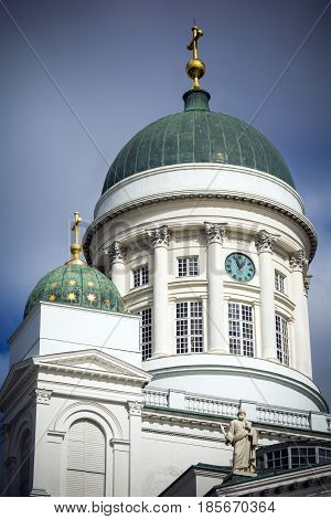Main dome of Helsinki cathedral with golden cross