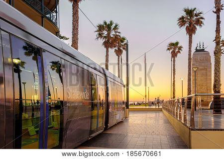 Adelaide Australia - November 11 2016: Tram ready to depart from Moseley Square to city at sunset. Moseley Square attracts a lot of tourists every day.