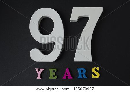Letters And Numbers Ninety-seven Years On A Black Background.