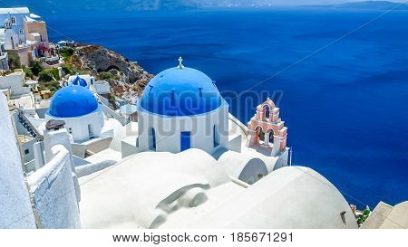 view of Oia in Santorini and part of caldera blue church