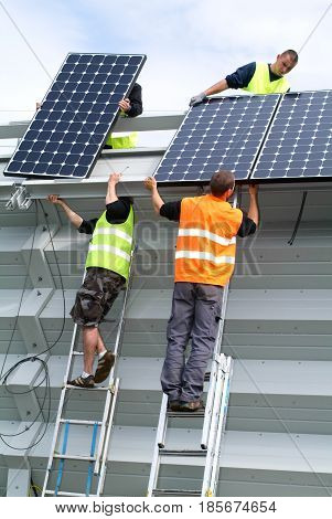 Workers During The Installation Of Solar Panels