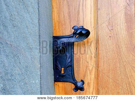 Historic door handle. Wrought black door handle.