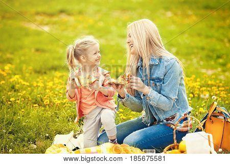 Mum And Daughter Enjoying Picnic In Park