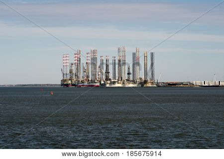 ESBJERG DENMARK - MAY 5 2017: Oil platforms in Esbjerg harbor. View from ferry from Esbjerg to Fano in the Danish wadden sea. May 5 2017.