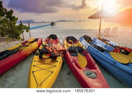 sea kayak on sand beach against beautiful sun rising sky at nyaung oo phee island andaman sea myanmar