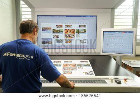 Printer Checking A Print Run At Table