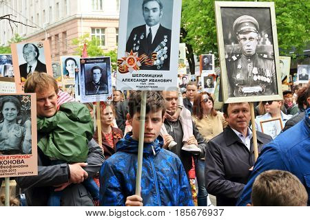 KURSK RUSSIA - May 92017: People in the crowd participating in Immortal Regiment procession in Victory Day. Close-up view.