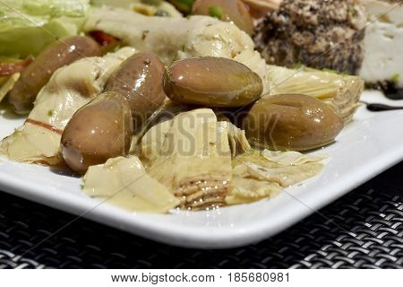 Traditional maltese food, maltese starter with olives, onion, vegetables. Traditional maltese appetizer with olives, cheese, tomatoes and zucchini. Maltese cuisine