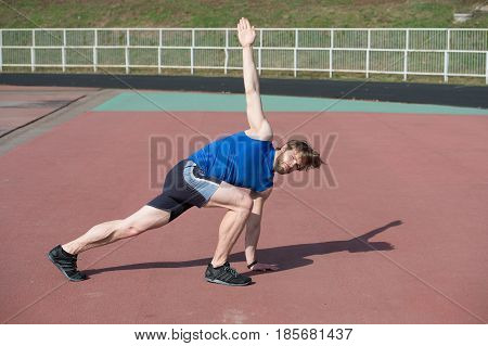 Athletic Bearded Man With Muscular Body Doing Exercises
