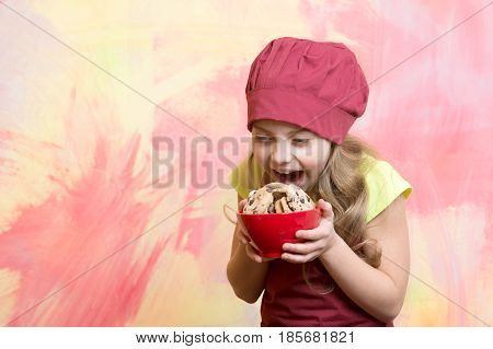 Small Girl In Red Chef Hat, Apron With Chocolate Cookies
