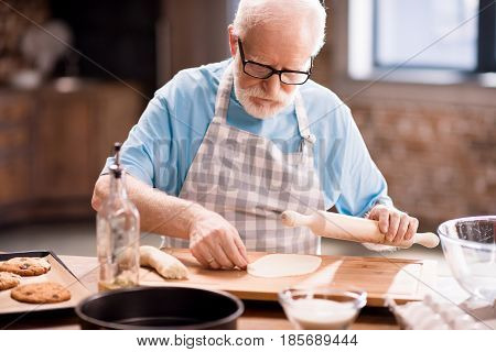 Senior Man Kneading Dough