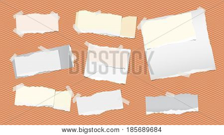 Pieces of ripped white and colorful note, notebook, copybook paper strips stuck with sticky tape on squared orange background