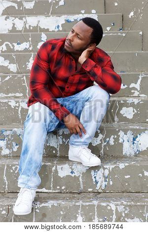 Cool Young Black Guy Sitting On Steps