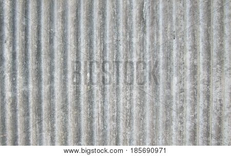 Old gray zinc. The fence in the country house has long been used as a rusty can be used as a background