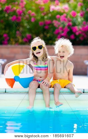 Kids Playing At Outdoor Swimming Pool