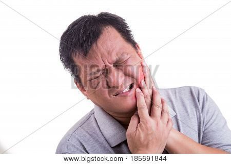 Matured Man Suffering Intense Toothache Pain With Hands Over Face