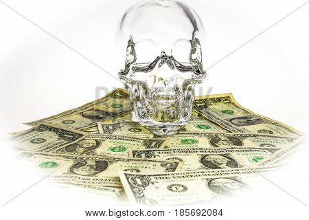 Crystal skull glass brainpan with dollars and white background