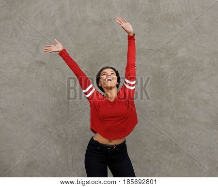 Happy Young Black Woman Laughing With Arms Raised
