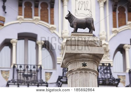 Torico bull sculpture and modernism facade in Teruel. Tourism Spain