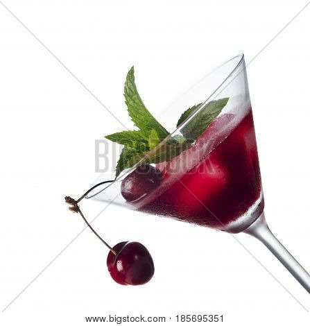 Cherry cocktail in martini glass isolated over white background