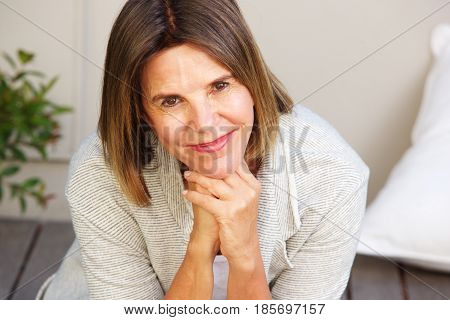 Attractive Older Woman Smiling And Sitting Outside