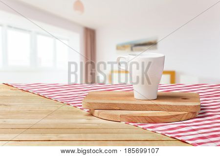 Wooden board with a napkin on a table