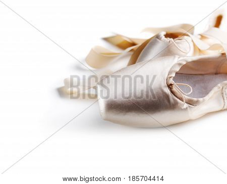 Pointe shoes isolated over white background. Ballet dance shoes.
