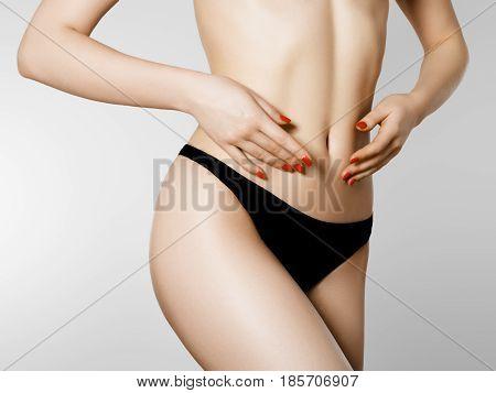 Women Health And Intimate Hygiene. Beautiful Woman's Body With Smooth Soft Skin In Black Bikini Pant