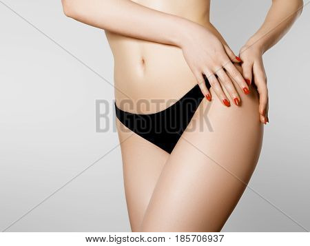 Women Health And Intimate Hygiene. Beautiful Woman's Body With Smooth Soft Skin In Black Bikini Pant