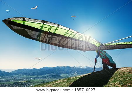 Hang-glider starting to fly in the mountain.