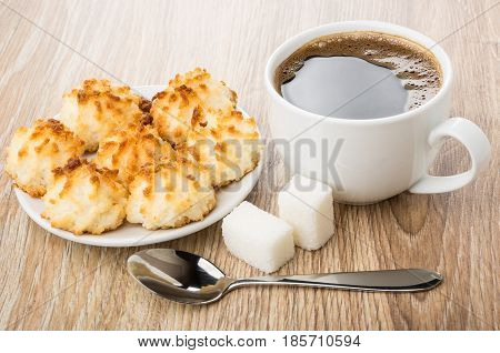 Black Coffee, Lumpy Sugar, Spoon And Saucer With Coconut Cookies