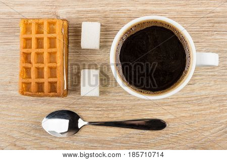 Soft Wafer, Lumpy Sugar, Spoon And Cup Of Black Coffee