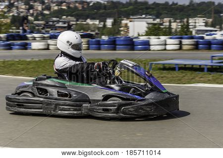 Karting Championship. Driver in karts wearing helmet. Karting show. Children, adult racers karting.